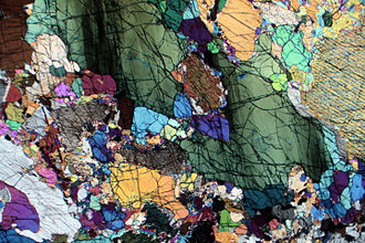 Wehrlite - Photomicrograph of a thin section of wehrlite, in cross-polarised light