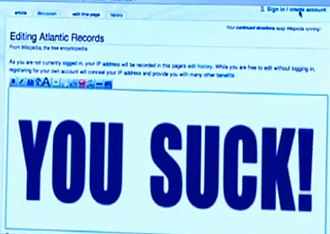 "Atlantic Records - ""Weird Al"" Yankovic edits the Atlantic Records' Wikipedia page to read ""YOU SUCK!"" in the music video for the song ""White & Nerdy"""