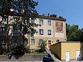 Wien-Penzing - Gemeindebau Rosentalgasse 15 mit Mosaik Sonnenuhr.jpg
