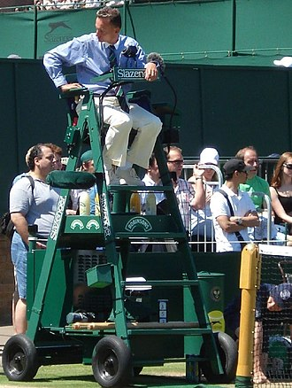 Official (tennis) - A chair umpire positions himself prior to a match at Wimbledon