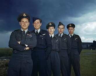 RAF Scampton - One of a series of iconic images of the members of 617 Squadron taken at RAF Scampton on 22 July 1943, and featuring (left to right) Wing Commander Guy Gibson; Pilot Officer P.M. Spafford; Flight Lieutenant R. E. G. Hutchinson; Pilot Officer G. A. Deering and Flying Officer H. T. Taerum.