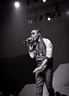 Wizkid at Iyanya's album launch concert, 2013.jpg