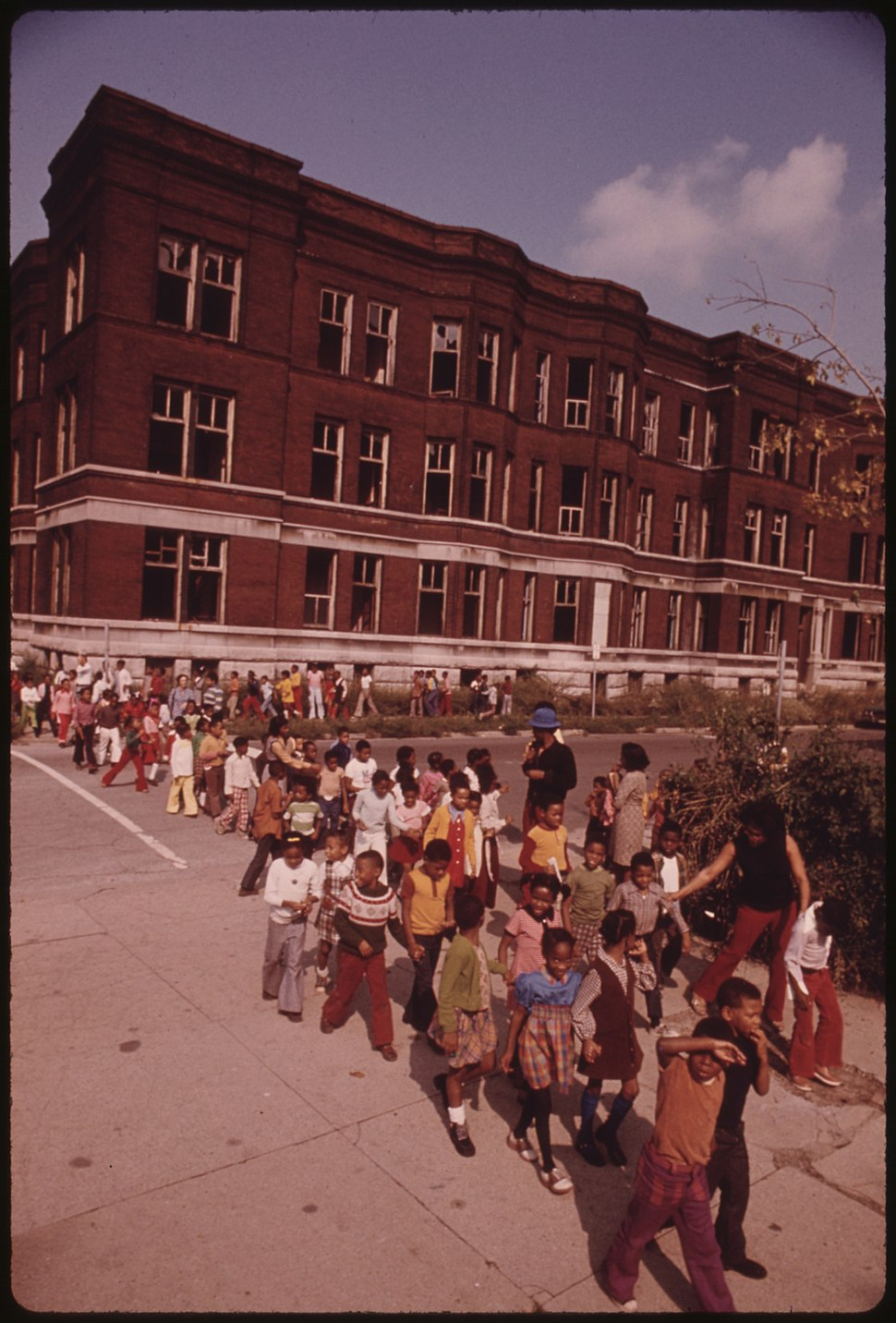 YOUNGSTERS RETURNING TO CLASS FOLLOWING A FIRE DRILL IN A CHICAGO ELEMENTARY SCHOOL. FIRE DRILLS ASSUME A GREATER... - NARA - 556265