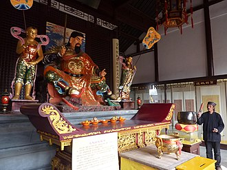 Xuanwu (god) - Zhenwu (Xuanwu) with the two generals, and the Snake and Tortoise figures at his feet, at the Wudang Temple of Yangzhou.