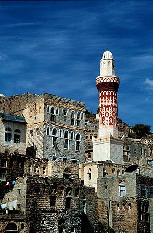 Minaret and town buildings in Jibla.