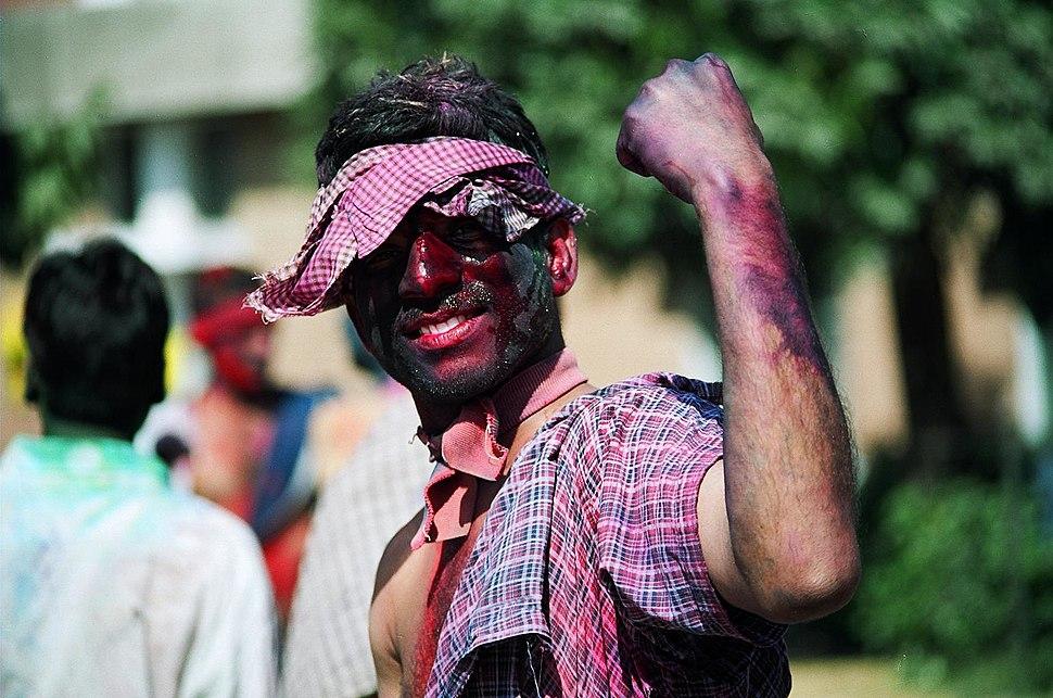 Young man celebrating Holi
