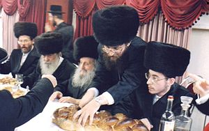 Izhbitza – Radzin (Hasidic dynasty) - Grand Rabbi Avraham Yissachor Englard of Radzin with his eldest grandson Rabbi Nosson Nachum Englard of Radzin-Yerushalayim (seated right)
