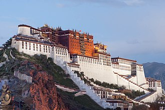 The Potala Palace to the west of the old city, now surrounded by recent buildings Bu Da La Gong .jpg