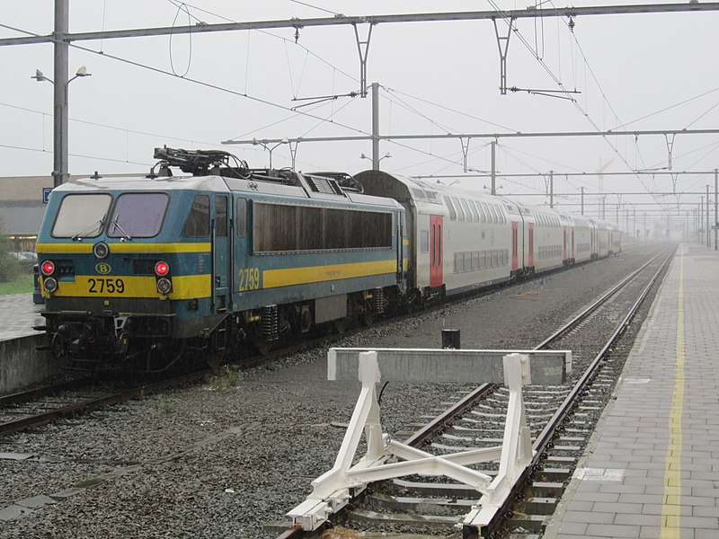 SNCB/NMBS class 27 no. 2759 is seen at Knokke on 12 October 2011. These locos on rakes of 5 double decker push-pull sets are now regular on the hourly InterCity (IC) services which join up at Brugge with a similar set at from Blankenberge. The 10 coach plus 2 loco formations then work through to Tongeren. Train seen here is IC1511, 11:06 Knokke to Tongeren.