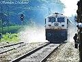 12436 Rajdhani Express blows dust as it passes by us at Salbari station - Flickr - Dr. Santulan Mahanta.jpg