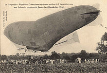 An damaged semi-rigid airship sags under the weight of its gondola.