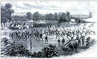 """1st Maryland Infantry, CSA - Camp Johnson, near Winchester, Virginia. This engraving shows the 1st Maryland Infantry Regiment """"playing football before evening parade"""". Published in Harper's Weekly on August 31, 1861. The Marylanders wear uniforms received in May and June 1861"""