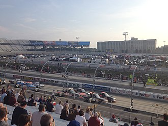 JEGS 200 - Trucks race on the front stretch during the 2015 race