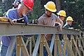 2016-366-86 Working Together on Bridge Across Pine Creek (25968860912).jpg