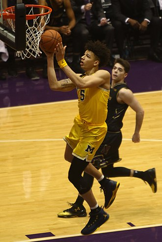 D. J. Wilson - Wilson in front of Bryant McIntosh for the 2016–17 Michigan Wolverines