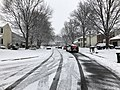 2018-03-21 10 15 58 View north along a snow-covered Dairy Lou Drive (Virginia State Route 6843) at Dairy Lou Court (Virginia State Route 6844) in the Franklin Farm section of Oak Hill, Fairfax County, Virginia.jpg