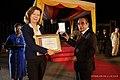 2019-08-30 Eine Vertreterin bekommt für die ACTU den Ordem de Timor-Leste von Francisco Guterres.jpg