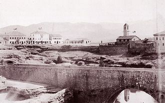 Podgorica - View of Ribnica fortress and Old bridge, Catholic Church (right), Debbaglar Bridge, government mansion and the Mirko Varosh Hotel (far left), before 1901.