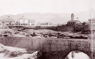 Podgorica - View of Ribnica fortress and Old bridge, Catholic Church (right), Debbaglar Bridge, government mansion and the Mirko Varosh Hotel (far left), before 1901.
