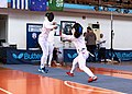 2nd Leonidas Pirgos Fencing Tournament. Forward lunge by the fencer on the right, counter-attack by Eleftheria Mimigianni.jpg