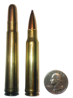 .338 Winchester Magnum cartridge (right)