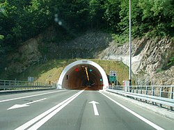 Road tunnel portal with variable traffic signs placed above the tunnel entrance