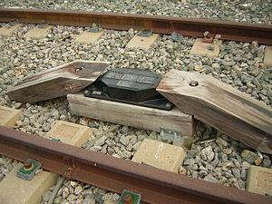 Anuncio de Señales y Frenado Automático - Track-mounted balise used for ASFA