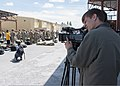 A Kyrgyz television photographer records video of U.S. troops as they process through customs April 30, 2013, at the Transit Center at Manas, Kyrgyzstan 130430-F-KZ210-011.jpg