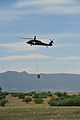 A U.S. Army UH-60 Black Hawk helicopter assigned to the Colorado Army National Guard provides firefighting assistance for the Black Forest Fire in El Paso County, Colo., June 12, 2013 130612-Z-WF656-005.jpg