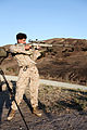 A U.S. Marine Corps scout sniper with Weapons Company, 1st Battalion, 1st Marine Regiment, 1st Marine Division fires an M40A1 rifle during a distance range with Canadian and New Zealand service members as part 130612-M-SF473-049.jpg