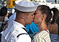 A U.S. Sailor, left, assigned to the guided missile destroyer USS Chung-Hoon (DDG 93), gives his farewells as the ship prepares to depart Joint Base Pearl Harbor-Hickam, Hawaii, April 2, 2013, for a deployment 130402-N-WF272-007.jpg