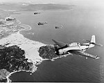 A formation of TBF Avenger aircraft of air group four approaching the coast of French Indochina on 12 January 1945.jpg