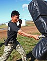 A member of the Mongolian Armed Forces participates in a pepper spray qualification course as part of the Non-Lethal Weapons Executive Seminar (NOLES) 2013 field training exercise Aug. 21, 2013, at the Five 130821-M-MG222-001.jpg