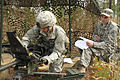 A paratrooper, left, assigned to the 3rd Brigade Combat Team, 82nd Airborne Division goes through the function check and clearing procedures for the MK-19 grenade launcher during testing of the Expert 131106-A-CK226-012.jpg