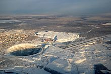 Aerial view of Mirny city, Mir mine and Mirny Airport.jpg