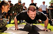 Airman executing a push-up as part of the United States Air Force Fitness Test