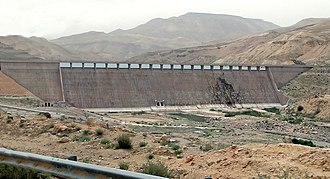 Water supply and sanitation in Jordan - The Mujib dam stores water from Wadi Mujib which is then mixed with desalinated water from brackish springs near the shore of the Dead Sea and then pumped up to Amman for drinking water supply.