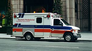 Cutaway van chassis - This Type III ambulance photographed in New York City is based upon a Ford cutaway van chassis with a modular body. The dual rear wheels add stability and weight capacity and the cutaway feature facilitates access between the cab and the patient care areas.