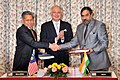 Anand Sharma and the Minister for International Trade and Industry, Malaysia, Mr. Mustapa Mohamed at the signing of the India-Malaysia Comprehensive Economic Cooperation Agreement (CECA).jpg