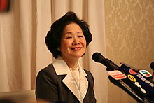 Anson Chan and news microphones 20051219.jpg