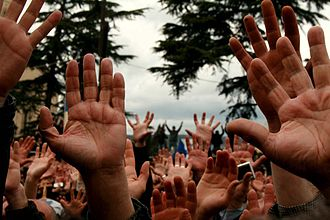 2009 Georgian demonstrations - Protesters hold up their hands to show that they don't have weapons