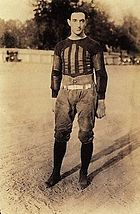 Football player in uniform, standing
