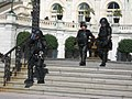 Armored Policemen in front of the U.S. Congress (1577610748).jpg