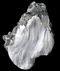 Fibrous asbestos on muscovite
