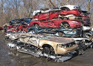 Crushed cars stacked at an auto scrapyard phot...