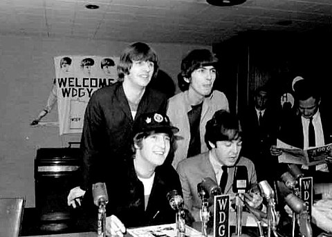 The band at a press conference in Minnesota in August 1965, shortly after playing at Shea Stadium in New York Beatles press conference 1965.jpg
