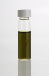A vial containing a dark green-brownish oil