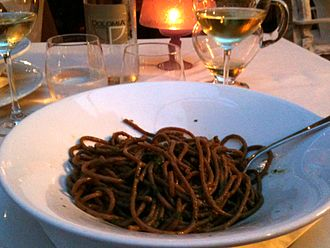 Bigoli in salsa - Bigoli with anchovy sauce at a restaurant in Venice, Italy