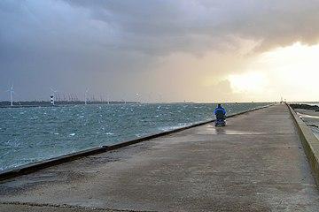Brave woman in electric wheelchair on stormy pier in Hoek van Holland.jpg