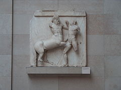 Sculpture of a fight between a man and a centaur.